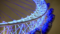 Stock Video Footage of close up night view of london eye observation wheel on river thames, LOOP