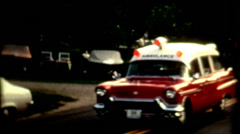 Vintage 1960s red and white Ambulance with lights flashing historic outdoors Stock Footage