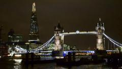 london nightscape view of tower bridge and the shard with thames river water - stock footage