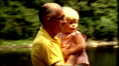 1960s young girl carried grandpa memorable family vintage fashion people life Stock Footage