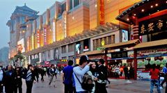 Stock Video Footage of People roam the Wangfujing Walking Street at dusk,Beijing,China