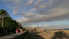 Spain - Gran Canaria - Maspalomas - promenade close to the sand dunes Stock Footage