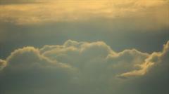 Sun's rays illuminate the grey soft clouds Stock Footage
