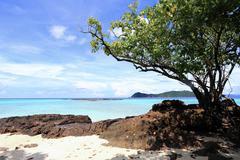beautiful island against blue sky - stock photo