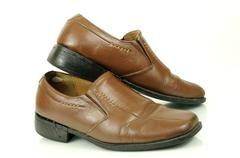 Old leather shoes Stock Photos