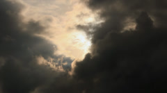 Light spot on black sky clouds Stock Footage