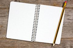 Stock Photo of spiral notebook and pencil