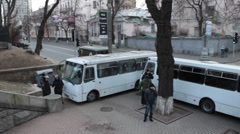 The Police preparing the streets for the forthcoming strike (fences by buses). - stock footage