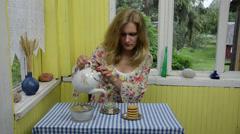 Woman prepared healthy dried camomile tea Stock Footage