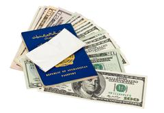 Package with drug over the afghan passport and u.s. dollars Stock Photos