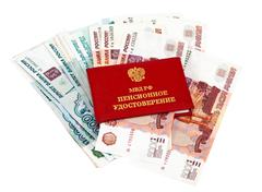 Russian pension certificate and money over white Stock Photos