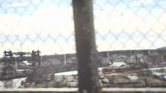 Industrial city view with chain link fence - stock footage