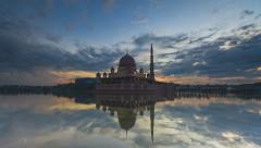Timelapse of Night to Day of Putra Mosque by the lake in Putrajaya pan & zoom in Stock Footage