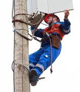 Electrician opened the control panel on the pole reclosers Stock Photos
