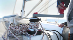 Sailor's hand on a winch of sailing boat Stock Footage