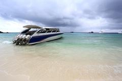 Speed boat anchored on beautiful Stock Photos