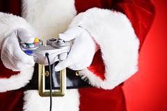 Santa: playing a video game Stock Photos