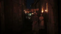 Women in alley by night Stock Footage