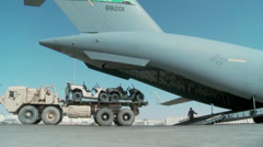 Loading vehicles on the C-17 Globemaster III operations Stock Footage