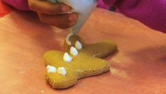 Putting Icing On Christmas Gingerbread Man Cookie Stock Footage