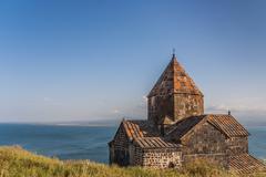 church and sevan lake in armenia - stock photo