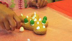 Putting Gum Drops On Christmas Gingerbread Man Cookie Stock Footage