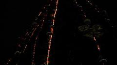 Garland light on dark christmas tree - stock footage
