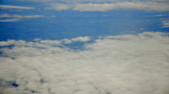 Flying in airplane over pacific ocean and clouds showing earth's atmosphere. Stock Footage