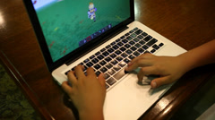 Boy Playing Popular Minecraft Game on Laptop Computer Stock Video Stock Footage