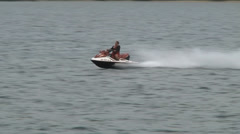 Waver runner jetski going by Stock Footage