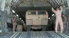 Offloading vehicle from the C-17 Globemaster III operations Stock Footage