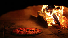 0184 Pizza cooking in a stone oven Stock Footage