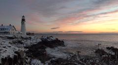 Inspiring Sunrise at Lighthouse on Rocky Coastline - stock footage