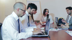 Business partners discussing documents and ideas at meeting Stock Footage