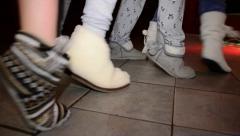 Twist feet in fur women's shoes Stock Footage