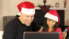 Father And Daughter Buying Christmas Gifts Online Stock Footage