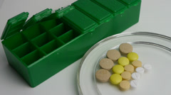 Medication box for the daily ration of a patient Stock Footage