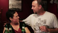 Lady at a bar is approached by a creepy guy 2 Stock Footage