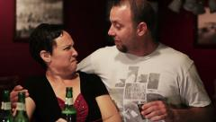 Lady at a bar is approached by a creepy guy 3 - stock footage
