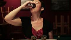 Lady drinking shots of liquor at a bar - stock footage