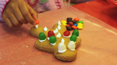 Adding Candy To Christmas Gingerbread Man Cookie Stock Footage