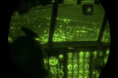 Night view from cockpit of C130 Hercules Night Drop Stock Footage
