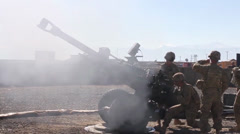 Soldiers  Fire M119 Howitzer canon Stock Footage