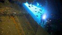 Scuba diving inside shipwreck Stock Footage