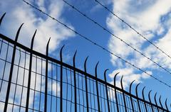 Spiked fence silhouette Stock Photos