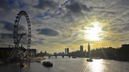 Stock Video Footage of boats passing thames river with sunset silhouette london skyline of eye, big ben