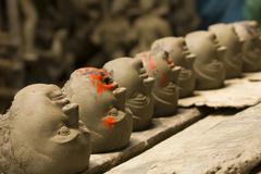 Series of clay heads Stock Photos