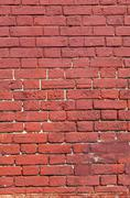 weathered texture of stained old red brick wall background - stock photo