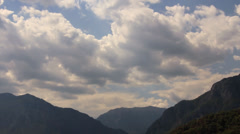 Clouds over mountain valley - stock footage