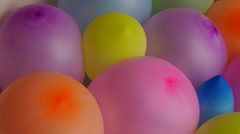 Stock Video Footage of compressed colorful balloons no. 01